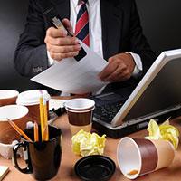 businessman-at-messy-desk