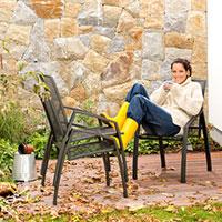 woman-cleaining-autumn-patio