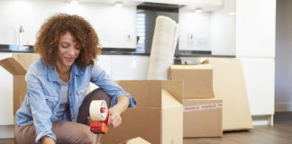 Woman Packing Boxes for Self Storage Unit