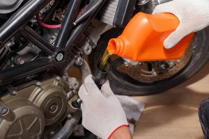 Change your motorcycle's oil before winter storage.